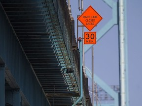 Construction signs warning of lane reductions can be seen on the Ambassador Bridge on Sunday, Sept. 4, 2016.  Concrete barriers have been put in place between traffic and the curb due to an emergency directive from Transport Canada after the agency found safety deficiencies on the Canadian side of the  bridge.