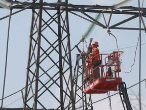 Technicians work at a hydro station near Lauzon Parkway and E.C. Row Expressway on Sept. 6, 2016, in Windsor, Ont. A massive outage occurred in Windsor and parts of Essex county.