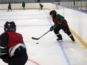 WMHA atom minor AA team practises at Adie Knox Arena, where LOOK UP warning lines have been painted on the ice surface for hockey players to be aware of danger zone around the boards, on Sept. 6, 2016.