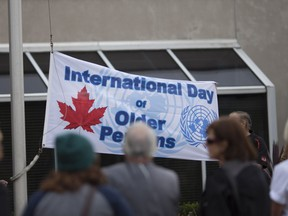 A flag is raised at city hall in honour of International Day of Older Persons, Saturday, Oct. 1, 2016.