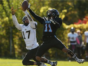 The AKO Fratmen's Tyler Storie and the Hamilton Hurricanes Zeph Fraser leap for a pass at E.J. Lajeunesse Field in Windsor on Oct. 22, 2016.