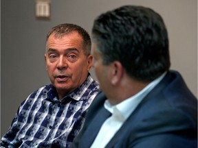 In this file photo, Windsor Regional Hospital CEO David Musyj, right, and hospital committee co-chair Dave Cooke talk with the Windsor Star editorial board Tuesday about the $2-billion mega-hospital project.