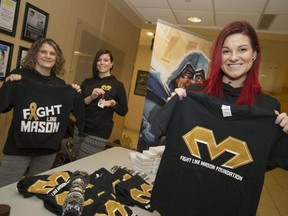 Chantelle Bacon, right, Mason's mother, is joined by volunteers Denise Sauve, left, and Kristen Movassut as they sell items from the Fight Like Mason Foundation at Windsor Regional Hospital's Met Campus on Dec. 21, 2016.