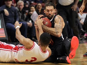 The Windsor Express' Brandan Kearney, bottom, fights for the ball with Jameson Tipping of the Orangeville A's during NBL of Canada action at the WFCU Centre on Friday, Dec. 30, 2016.