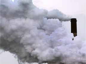 Smoke pours out of a stack on Zug Island on Feb. 26, 2015. The United States accounts for 15 per cent of global emissions while Canada produces 1.7 per cent.