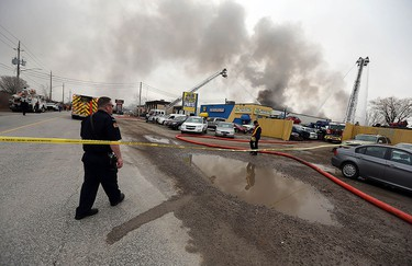 Firefighters battle a fire behind J&B Auto Parts on Provincial Road in Windsor on Thursday, March 9, 2017.
