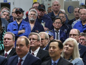 Ford workers, standing at the Ford Essex Engine Plant in Windsor, Ont., listen to a major investment announcement on March 30, 2017.