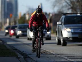 Tony Chau cycles along McDougall Avenue in Windsor on March 8, 2017. Chau has had several close calls with drivers while commuting.