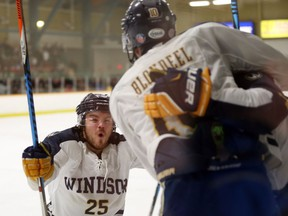 Windsor's Kyle Haas congratulates Blake Blondeel following a goal against York at the South Windsor Recreation Complex on March 1, 2017.
