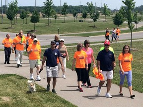 LaSalle Mayor Ken Antaya, second from right, joins a walking group during the County Wide Active Transportation System event near the Vollmer Complex in LaSalle, Ontario on May 31, 2016.