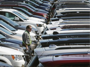 Newly built minivans sit in a shipping lot at the FCA Canada Chrysler Windsor Assembly Plant on April 24, 2017.