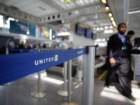 This file photo taken on April 12, 2017 shows an airport worker walking through the United Airlines terminal at O'Hare International Airport in Chicago, Ill.