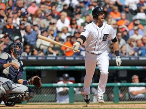 Andrew Romine of the Detroit Tigers hits a fourth inning grand slam during the game against the Minnesota Twins on April 12, 2017 at Comerica Park in Detroit, Michigan.