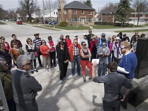 A group of approximately fifty people take part in the South Walkerville walking tour Sunday, April 9, 2017.