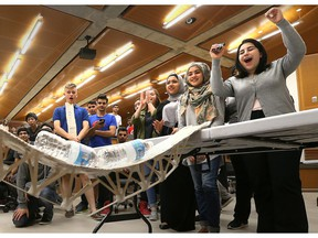 Vincent Massey Secondary School students cheer as a bridge, constructed from popsicle sticks, is tested during Massey Day at the University of Windsor engineering school on April 27, 2017.