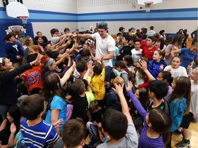National Football League player Luke Willson paid a visit to Holy Cross Catholic Elementary School May 26, 2017 to speak with students and staff.