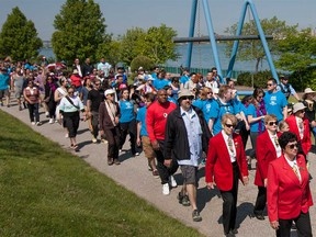 Citizens stroll on Windsor's riverfront for the annual Mayor's Walk in this May 2016 file photo.