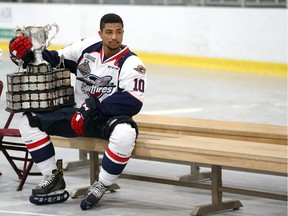 The Windsor Spitfires Jeremiah Addison sits with the Memorial Cup as the team prepares for the official team portrait at the WFCU Centre in Windsor, Ontario on May 30, 2017.