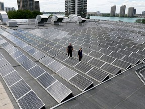 Karina Richters, front, and Daryl Brisbois with hundreds of solar panels on top of City of Windsor owned Windsor Aquatic and Training Centre and Adventure Bay Family Water Park June 21, 2017.  The panels collect 350 kilowatts.