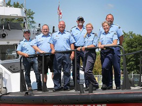 Members of Amherstburg's Canadian Coast Guard and Auxiliary stand aboard the Colchester Guardian on July 18, 2017. From left: Herb Ruthven, Mike Drexler, and Jim Oakley of the Colchester Guardian; Greg Colbeck, Sondi Ryersee, Jana Lorbetski, and Jeff Faucher of the Thunder Cape.