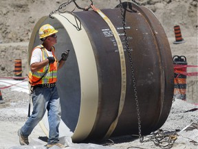 Crews work Tuesday at the construction site of Enwin's $25-million water reservoir project. The project involves building and connecting a new 35-million-litre underground tank to the A.H. Weeks water treatment plant at Wyandotte Street East and George Avenue.