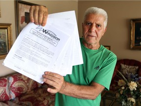 Marcello Rose, who lives on McKay Avenue in Windsor, with a petition, July 14, 2017, against a prayer day parking proposal that has upset neighbours living near the Windsor Mosque.