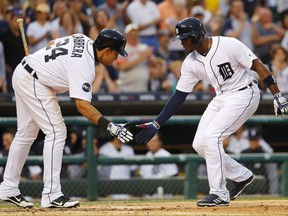 Detroit Tigers' Justin Upton, right, celebrates his solo home run with Miguel Cabrera (24) against the Los Angeles Dodgers in the fourth inning of a baseball game in Detroit, Friday, Aug. 18, 2017. (AP Photo/Paul Sancya)