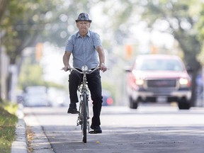 A cyclist rides north on Pillette Road, Monday, August 7, 2017.