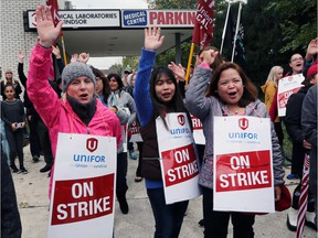 Striking medical lab assistants and technologists, members of Unifor Local 2458, picket outside the Medical Laboratories of Windsor building on Ouellette Avenue on Friday, Oct. 13, 2017.