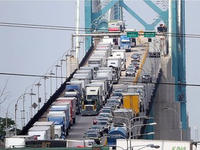 Traffic backs up entering Canada across the Ambassador Bridge between Windsor and Detroit on July 24, 2015.