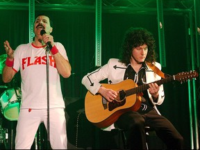 Members of the Queen cover band Simply Queen perform during a concert.