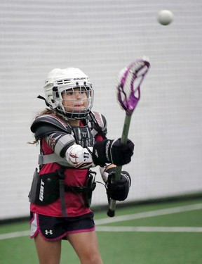 Lacrosse player Izabella King passes the ball during a  Windsor Minor Lacrosse Association clinic last year.