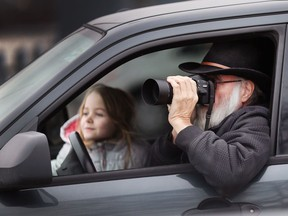 Eagle-eyed Dean Boufford and his granddaughter Nova Brown, 8, scan for bald eagles at Lakeview Park Marina, Jan. 23, 2018, after hearing reports that Windsor's eagle population has recently increased. Centred around Peche Island, up to 40 individual eagles have been spotted by avid bird watchers.