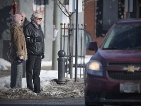 Walkerville residents Elaine Weeks and Chris Edwards wait to cross busy Wyandotte Street East at Chilver Road, Tuesday, Jan. 9, 2018, where Coun. Chris Holt has requested funds to put in a crosswalk.