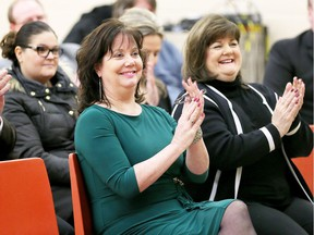 Erin Kelly, director of education for the Greater Essex County District School Board, left, and school board trustee Cheryl Lovell, right, applaud on Jan. 31, 2018, at the announcement of a new Eastwood/Parkwood Public School to be located on Wildwood Drive near Holly Crescent in Forest Glade