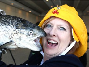 Rotary Club of Windsor-Roseland member Andrea Baillargeon simulates kissing a cod during a kickoff event for 34th Annual Lobsterfest - A Maritime Party, A Screech of a Good Time at St. Clair College Centre for the Arts March 20, 2018.  The actual Lobsterfest is May 25 at St. Clair College Centre for the Arts.