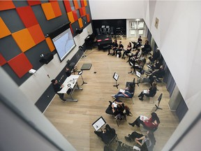 Music students are shown in a classroom during the University of Windsors grand opening for its School of Creative Arts on Thursday, March 22, 2018.