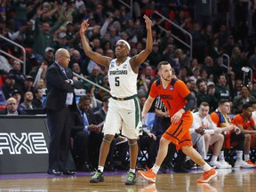 Michigan State guard Cassius Winston (5) reacts to hitting a basket against Bucknell during the first half of an NCAA men's college basketball tournament first-round game in Detroit in 2018.