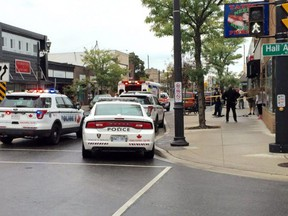 In this Sept. 28, 2016, file photo, Windsor police, paramedic and fire emergency response crews converge in the 1300 block of Ottawa Street following a brutal stabbing attack on an elderly woman.