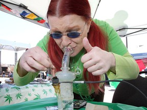 Dawn Foley demonstrates 'dabbing' (inhaling vapours) during Friday's 4/20 event at Charles Clark Square.