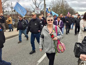 Sandy Marentette, wife of the late long-time activist Rolly Marentette, takes part in Windsor's march for the national Day of Mourning on April 28, 2018.