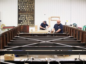 Wood craftsman Serge Legare, top, and metal fabricator Ray Ford work on Windsor's Streetcar 351 at RM Auto Restoration in Blenheim, Tuesday May 15, 2018.  Specialists at RM Auto Restoration are detailing every inch of the historic streetcar. An original route scroll, shown on back wall, was found inside the walls of Streetcar No. 351.