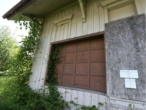 A public notice to sell the property is posted by Canadian National Railway on an exterior wall of the former Comber Railway Station on May 29, 2018.