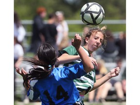 WINDSOR, ON. MAY 16, 2018. --  Lauren Hodgins, right, of the Lajeunesse Royals and Zohra Tabti of the Lamothe-Cadillac Falcons battle for the ball on Wednesday, May 16, 2018, during the WECSSAA senior girls' A soccer final in Windsor, ON. (DAN JANISSE/The Windsor Star)