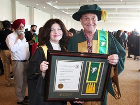 St. Clair College President Patricia France, left, poses with Ted Farron who was awarded an Ontario College Diploma in Culinary Management during St. Clair College's 51st Annual Convocation at St. Clair College Centre for the Arts' Chrysler Theatre  June 11, 2018. Monday's convocation was the first of seven convocations.  Farron was honoured for his continued dedication to the food service industry and his longtime support of St. Clair College and local education.