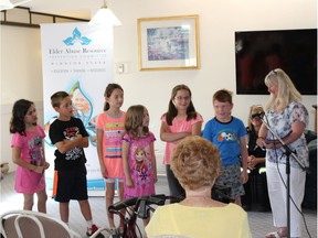 St. Anthony Grade 3 students, shown with their teacher Kate Marentette on June 15, 2018, visited Harrowood Retirement Home and spoke about the seniors who are important in their lives.
