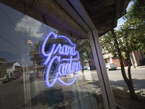 The Grand Cantina sign shines neon purple at the new Ford City restaurant, on July 12, 2018.