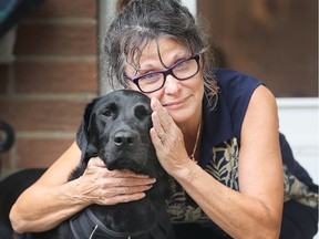 East Windsor resident Mary Dibbley and her Labrador Retriever, Stella, on July 20, 2018 - one day after an attack by loose dogs that Dibbley describes as pit bulls.