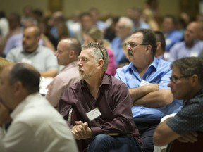 Representatives of local manufacturers listen attentively during a luncheon hosted at the Ciociaro Club on July, 17, 2018, by the Canadian Association of Mold Makers and dealing with the changing rules on U.S. tariffs that threaten local tool and die, mould-making and autoparts sectors.