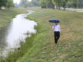 Phil Bartnik, Tecumseh's director of public works, walks through Lakewood Park on Manning Road on Aug. 16, 2018.